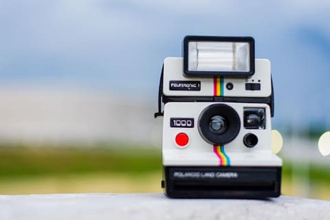 How to put film in a Polaroid Camera